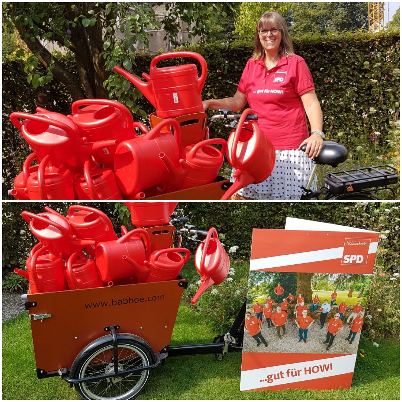SPD spendet rote Giesskannen für den kommunalen Friedhof